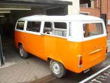 VW Camper Van with the round body structure in Ford focus orange