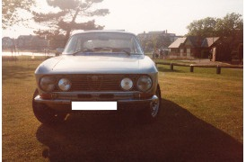 A picture of a Silver Alfa Romeo  105 Bertone 1600 GT Junior in white being restored after a crash.